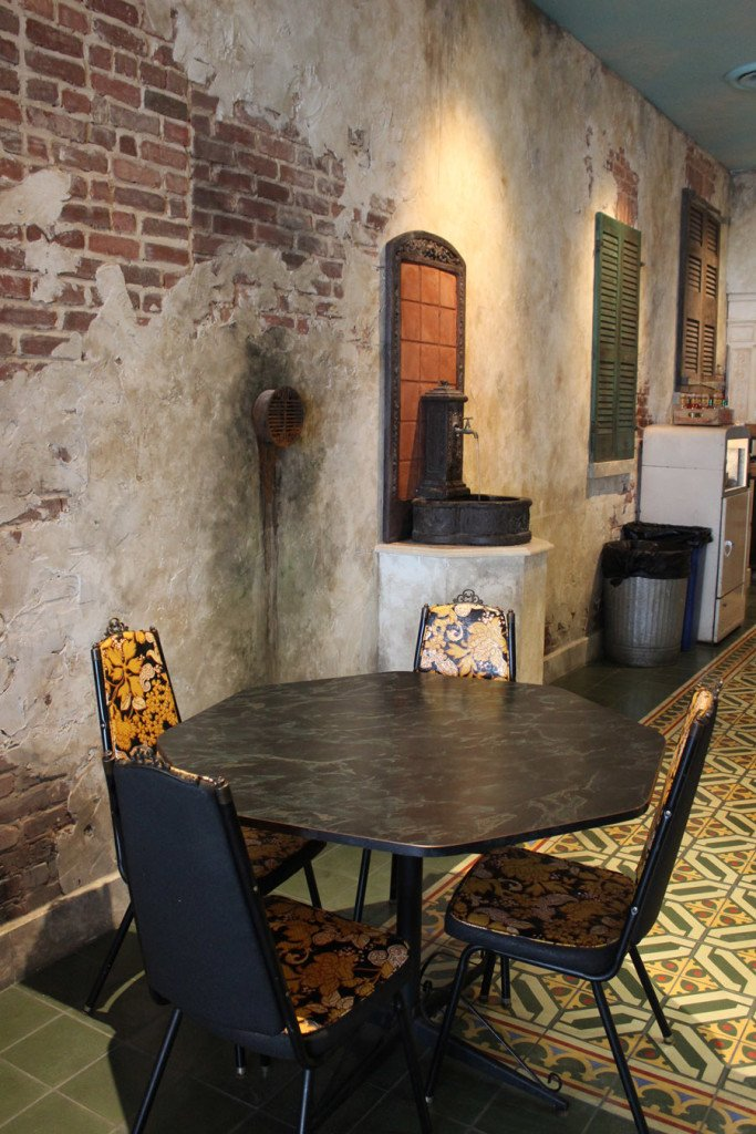 Distressed wall with traditional cement tiles