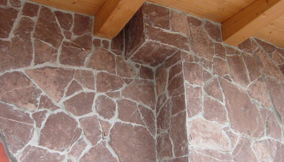 muri in pietra interni porfido