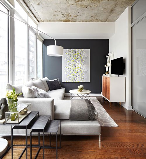 Come ingrandire gli spazi con il colore - parete scura