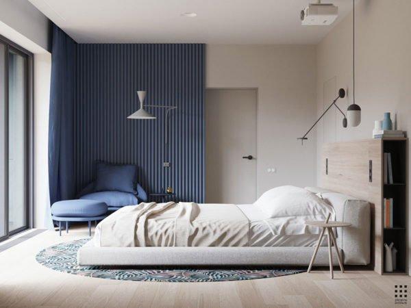 Camera da letto con parete e poltrona colore avio
